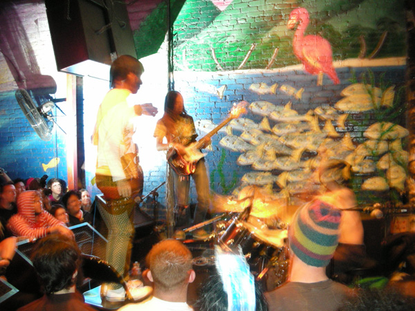 GREEN MILK FROM THE PLANET ORANGE captured in a rare stance as they stand up and progressive rocked the audience